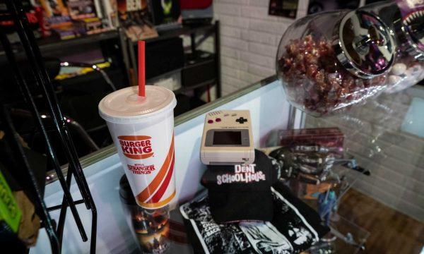 gameboy and soda on counter at video store